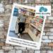 Vor einer Steinwand ist ein Polaroid auf dem Theresa Donner in der Buchhandlung »heiter bis wolkig« an einer Bücherwand lehnt. In der rechten oberen Ecke ist das Logo, eine lachende Wolke, hinter der eine Sonne vorkommt, abgebildet.